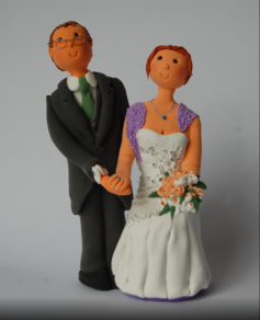 Cake topper couple man glasses woman lilac shawl jewelry nuptial